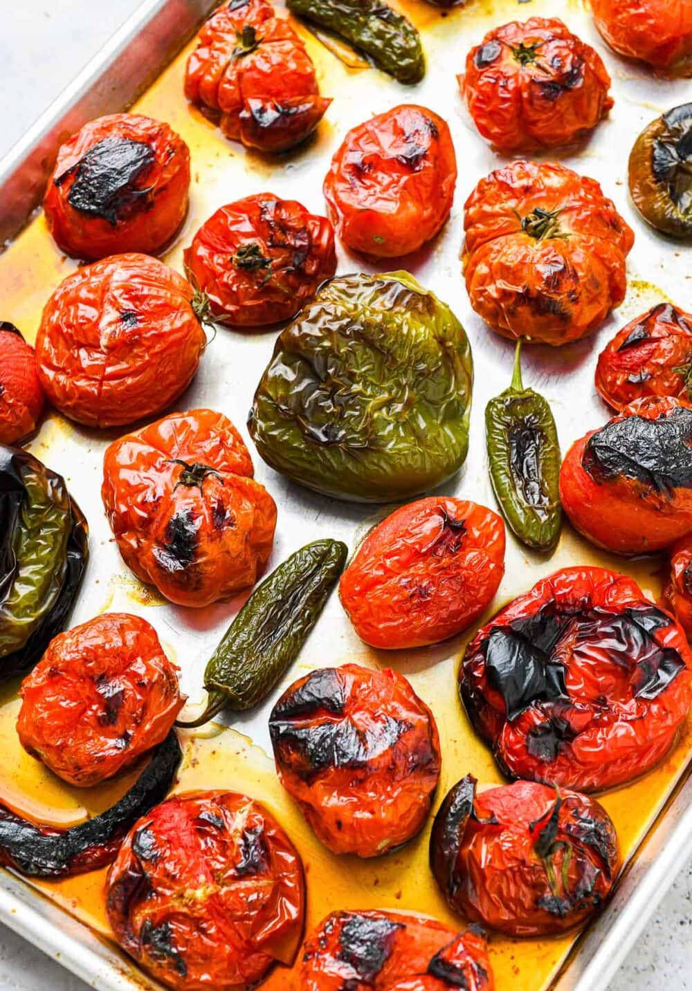 tomatoe, jalapenos, peppers, broiled on a sheet pan