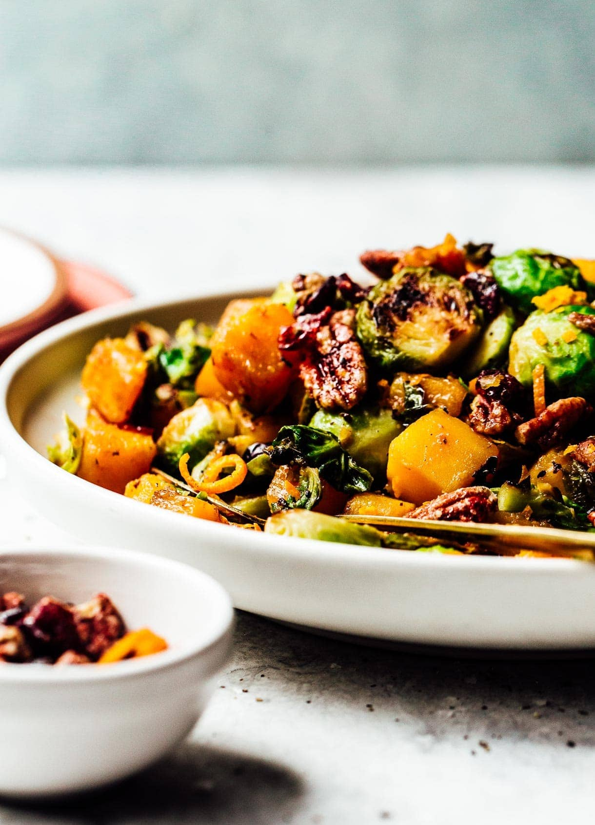 Orange Glazed Butternut Squash and Brussels Sprouts with pecans