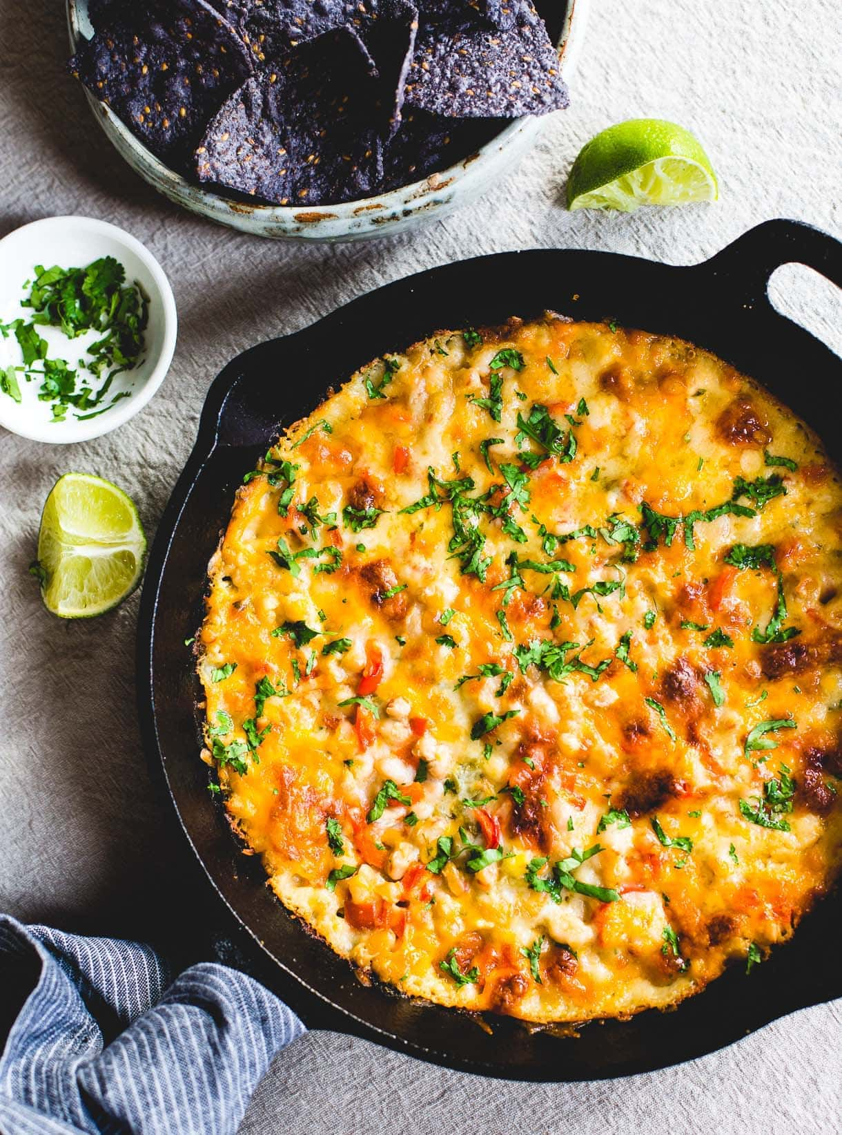 Skillet White Chicken Chili Dip -- easy to make, all cheesy and bubbly in a cast iron skillet. use rotisserie chicken.