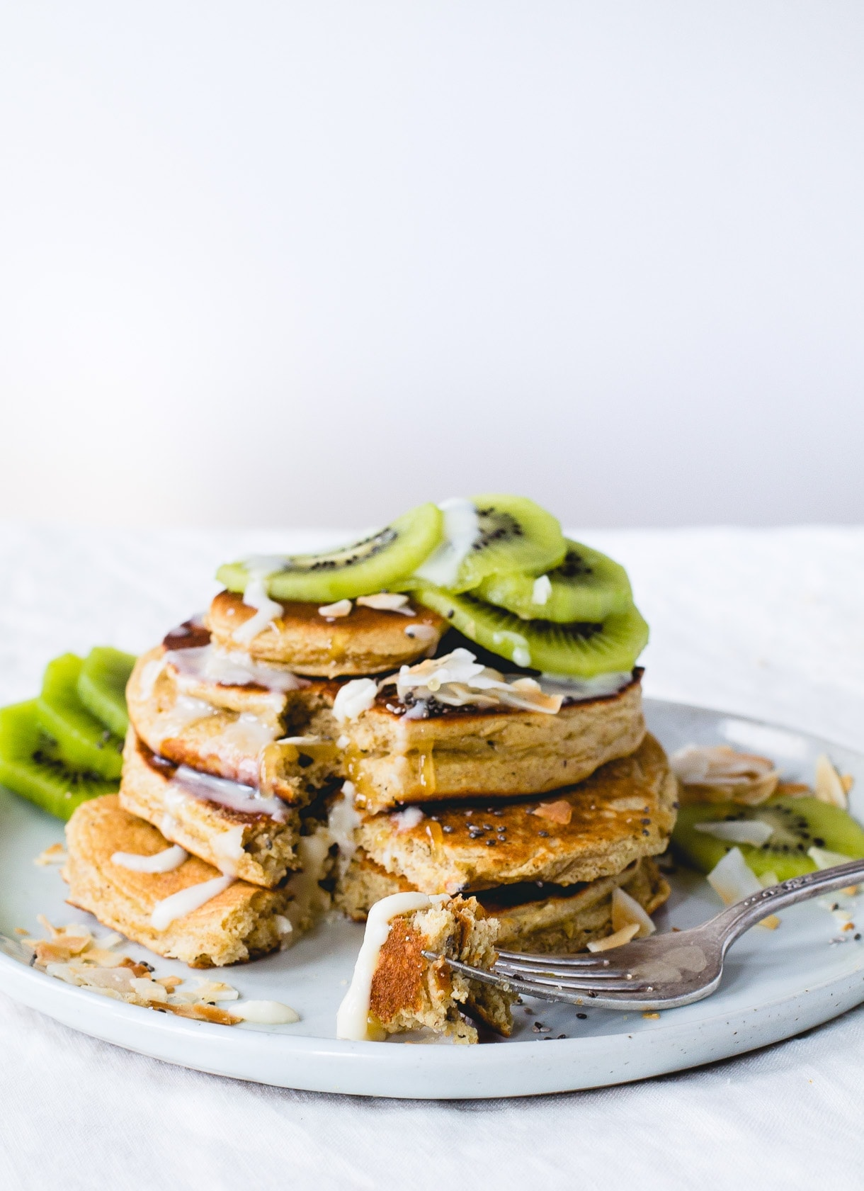 Fluffy Gluten-Free Pancakes with Coconut Butter & Kiwis.