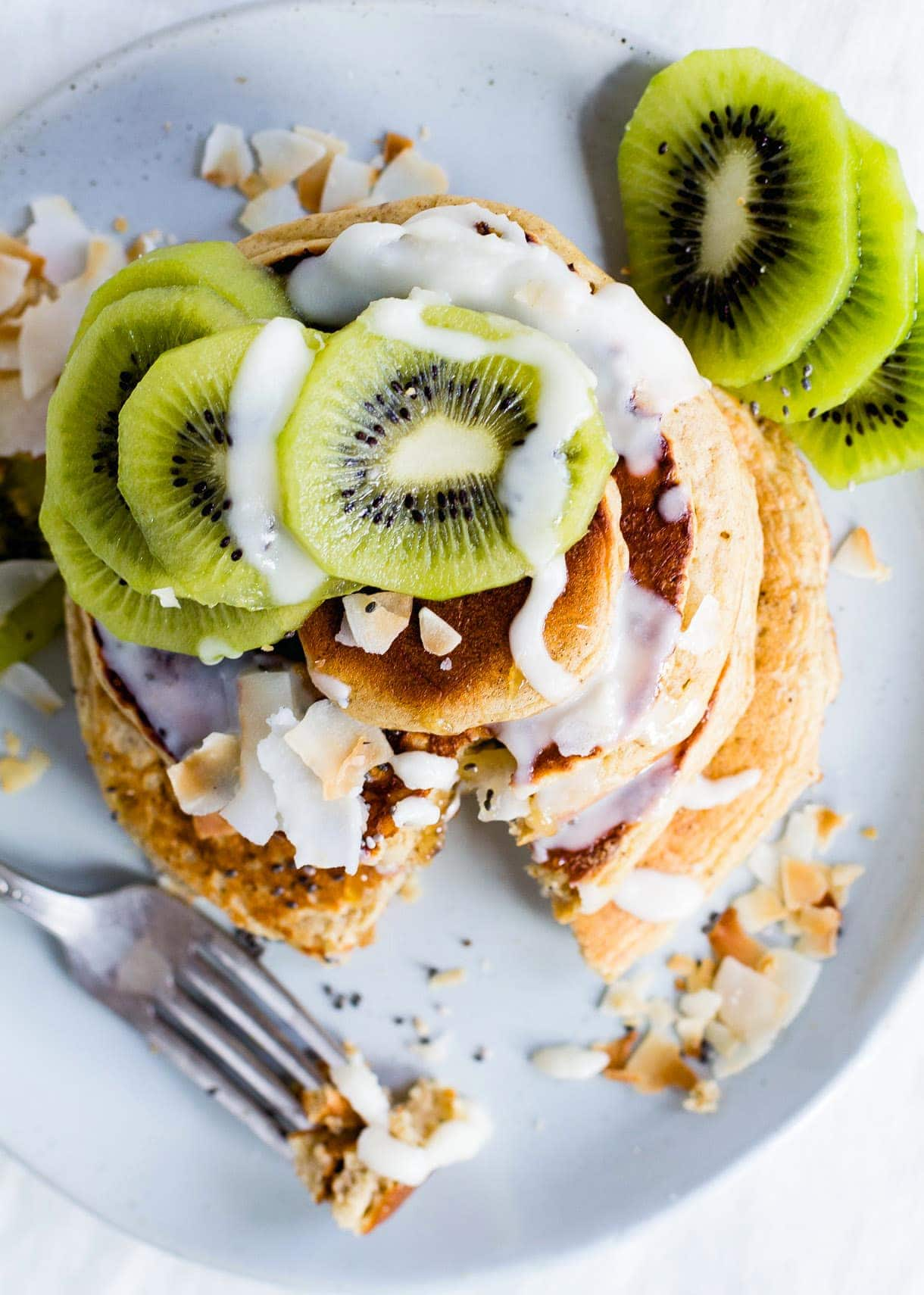 Fluffy Gluten-Free Pancakes with Coconut Butter Drizzle & Kiwis.