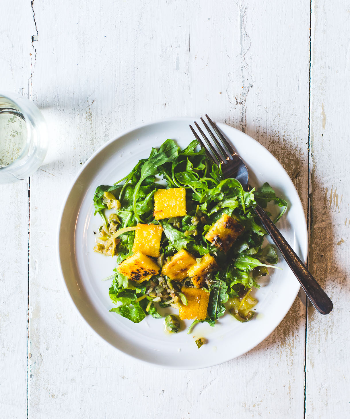 Fried Polenta Squares with Mixed Greens + Lemon Olive Salsa