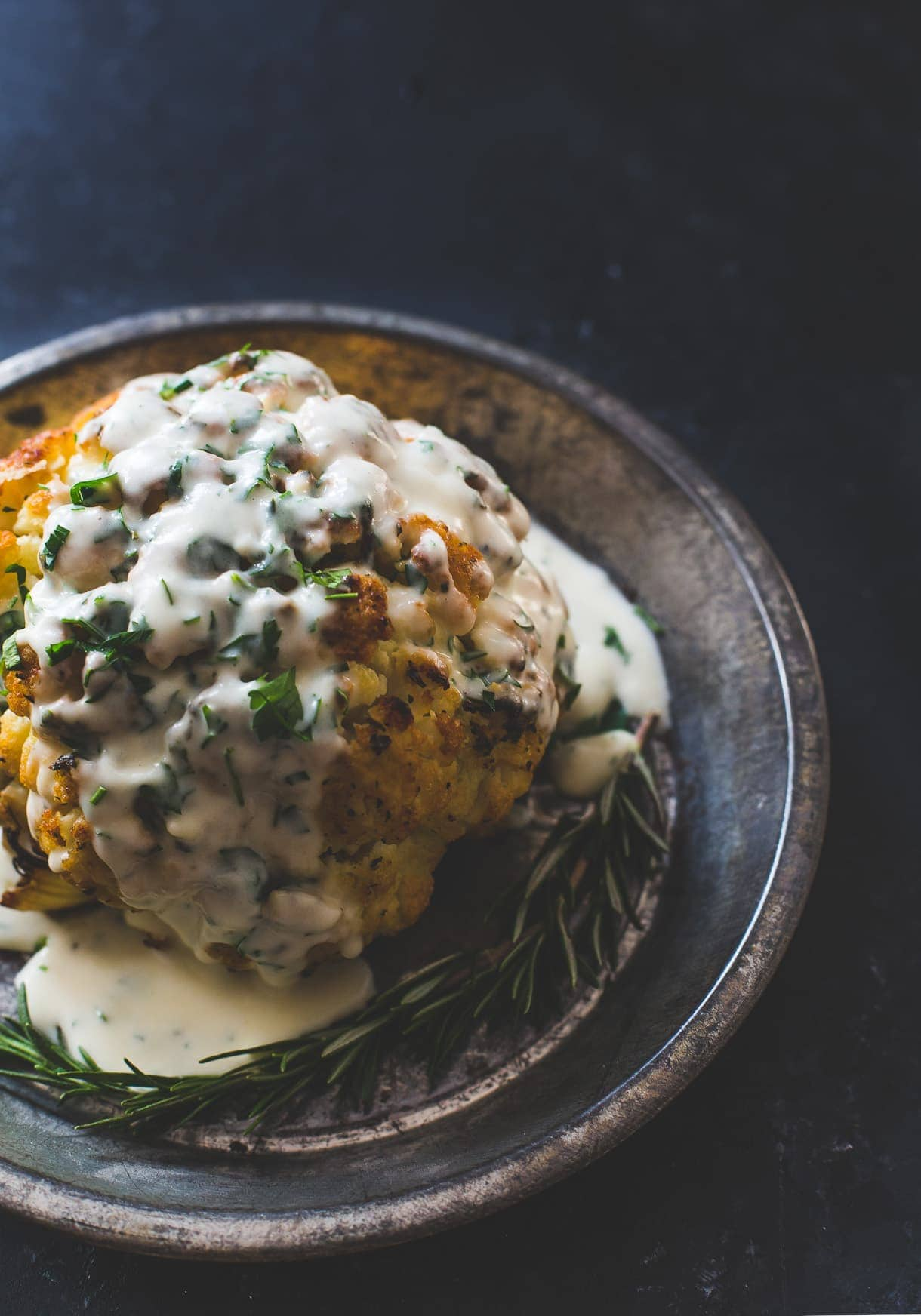 the best whole roasted cauliflower recipe, with fontina cheese sauce.