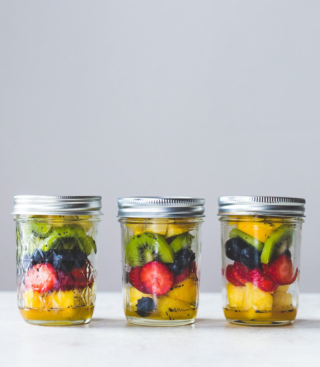 Honey Poppyseed Marinated Fruit Jars: the perfect make-ahead paleo snack in a mason jar, that can be stored in the refrigerator for up to 3 days.