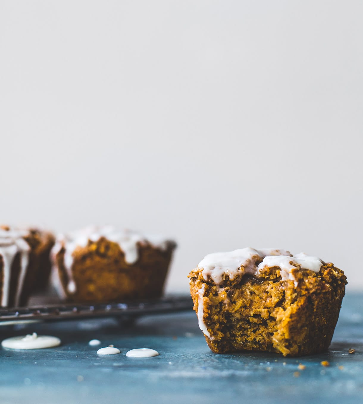 Deliciously Healthy Sweet Potato Muffins with Vanilla Icing -- vegan and gluten free, no bananas, made with teff flour