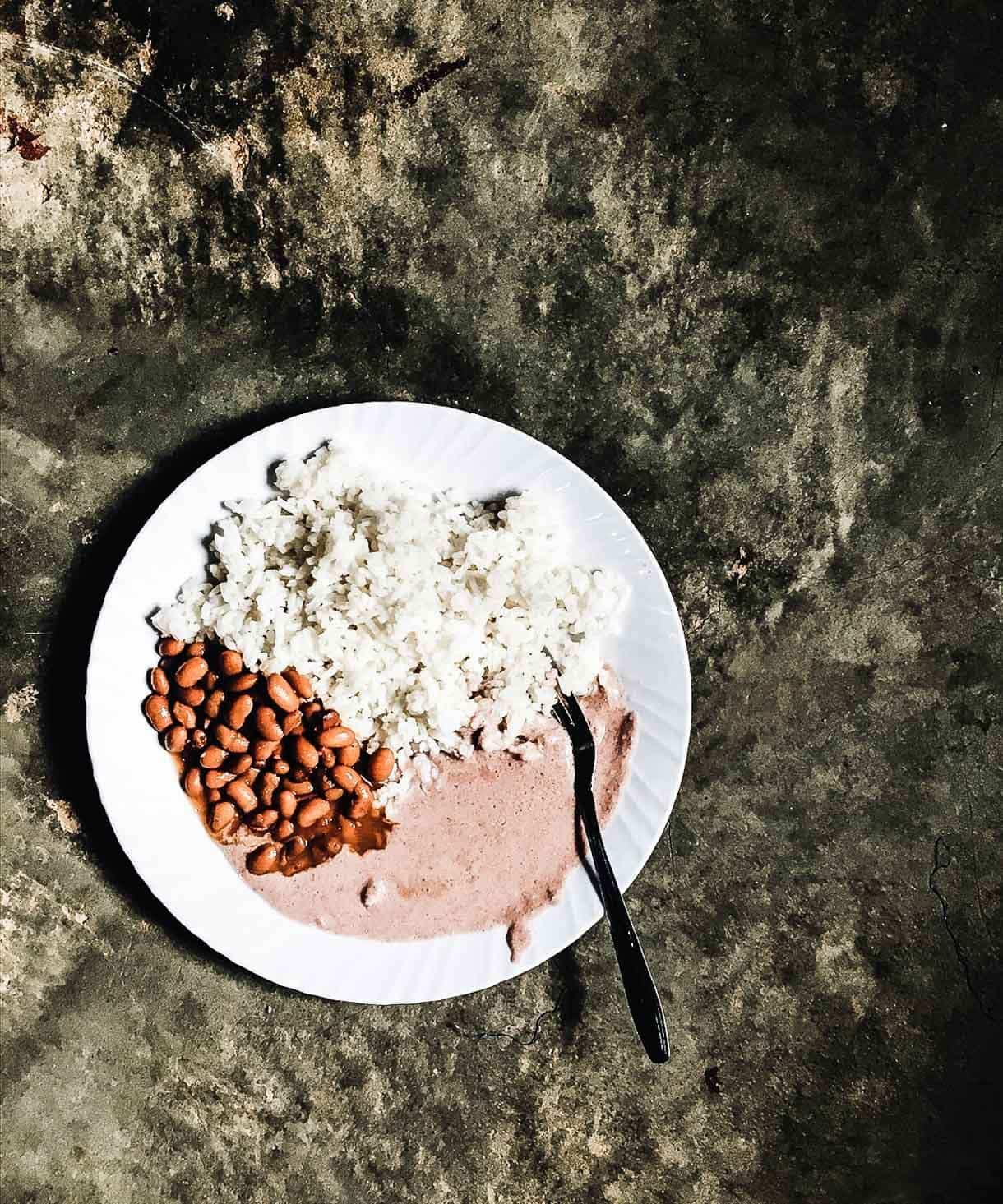 Nakivale - Rice and Beans lunch, with g. nuts sauce {ground peanut sauce}