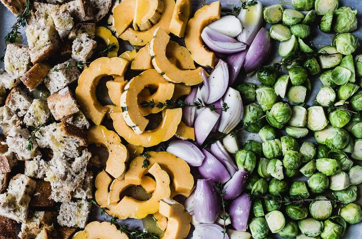 Vegetarian Sheet Pan Stuffing with squash, brussels sprouts, and shallots