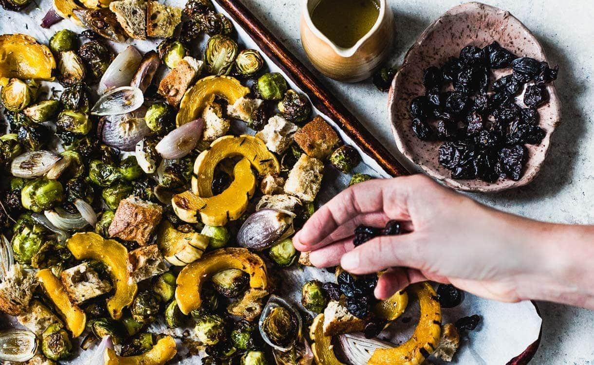 Vegetarian Sheet Pan Stuffing with squash, brussels sprouts, and dried tart cherries