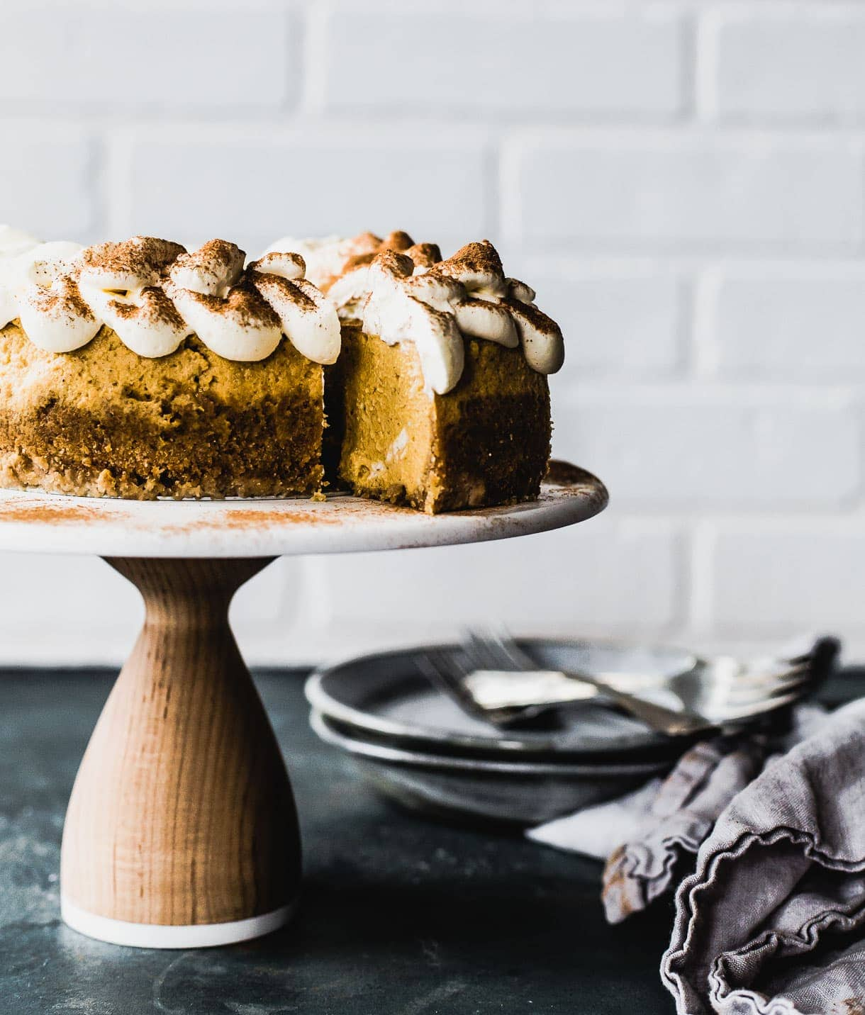 Cinnamon Dusted Pumpkin Cheesecake with gluten free crust