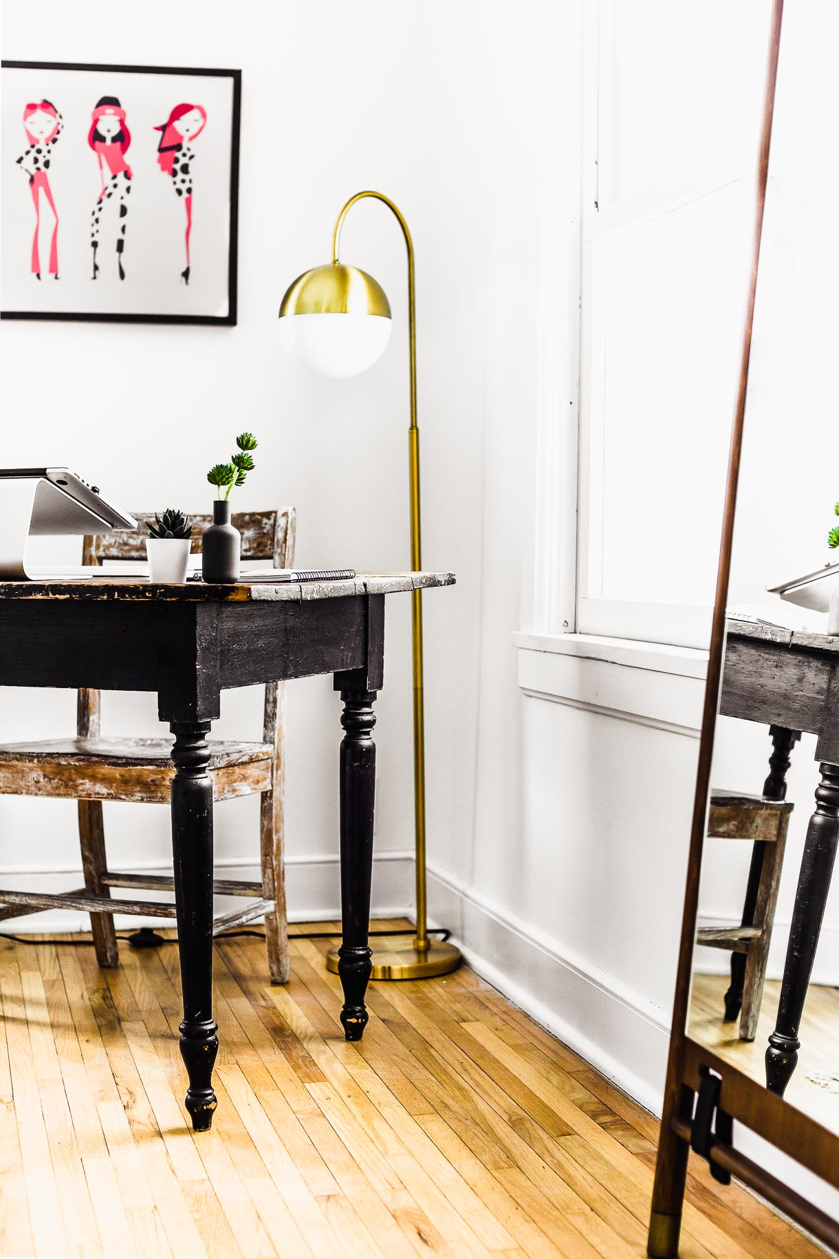 Vintage desk with gold floor lamp