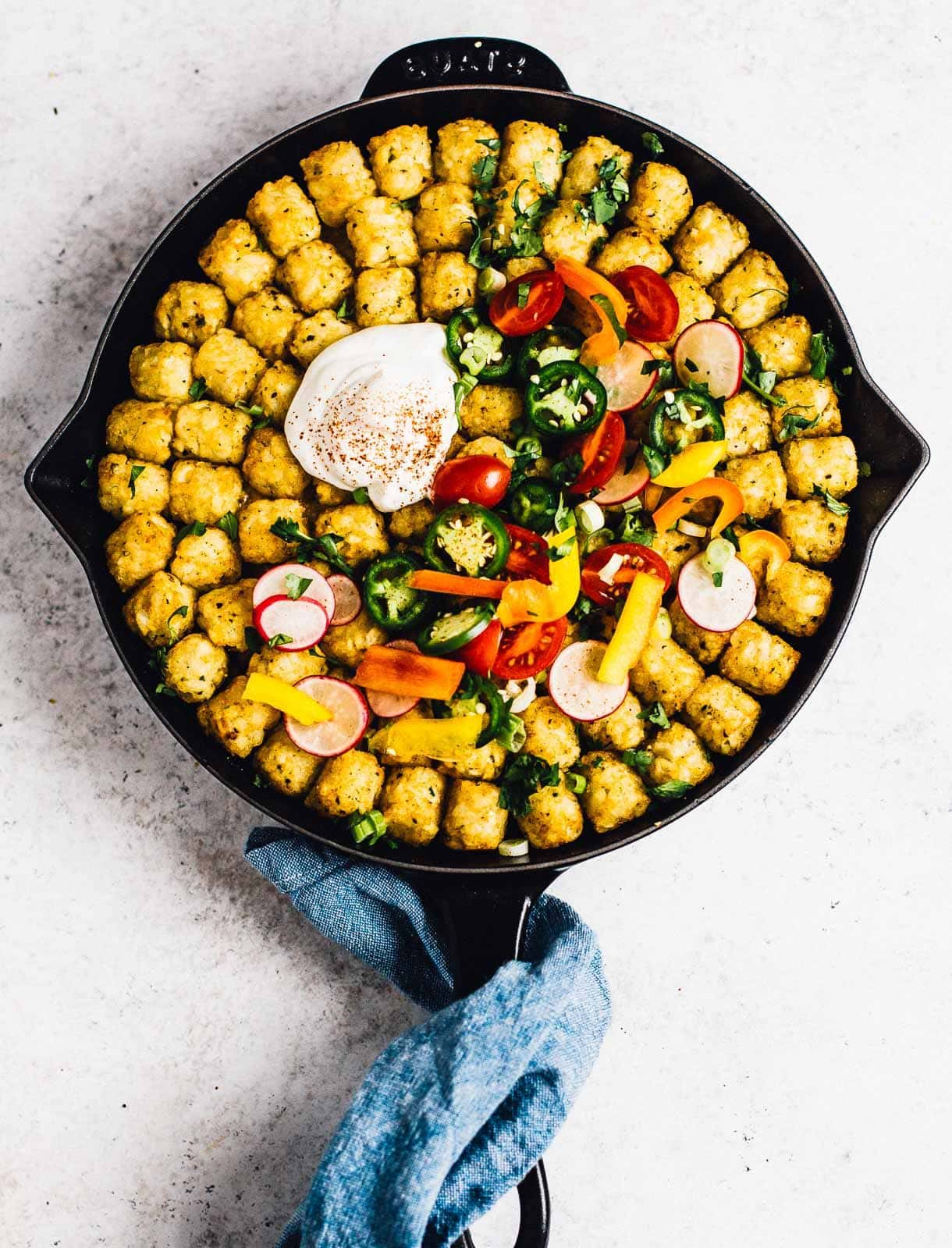 Taco Tater Tot Casserole in cast iron skilet