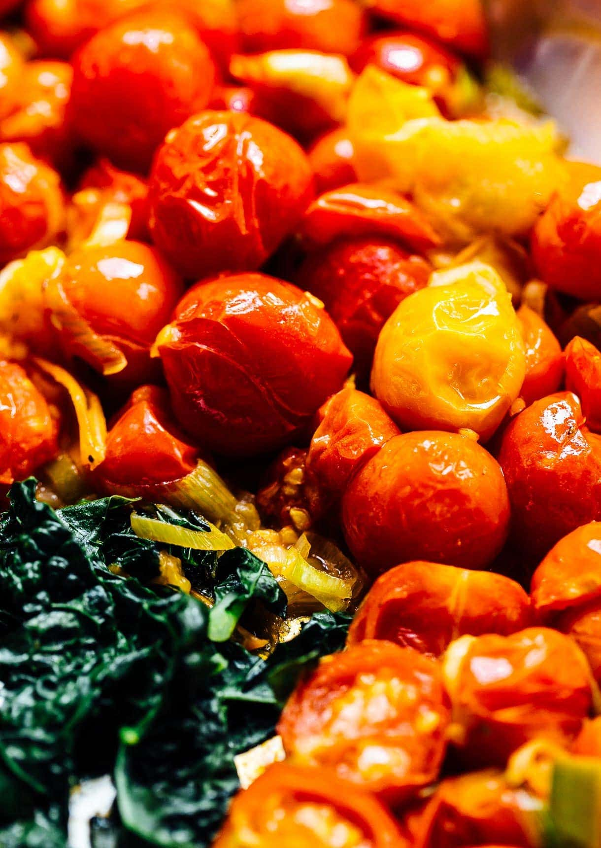 blistered cherry tomatoes with kale