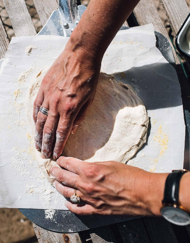 stretching sourdough pizza dough