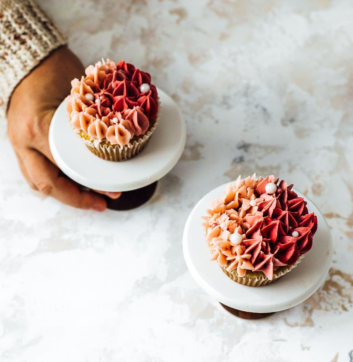 holding a cupcake stand