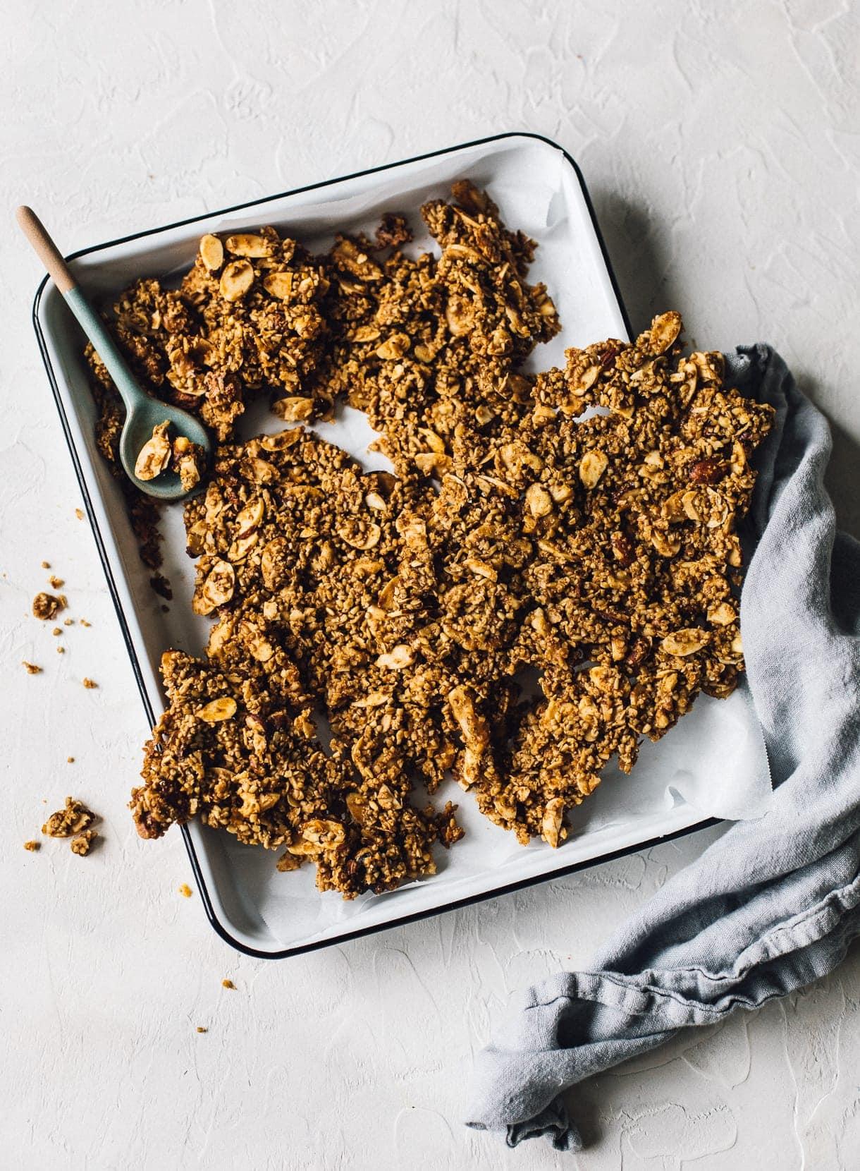 chunky vegan granola in an enamel pan