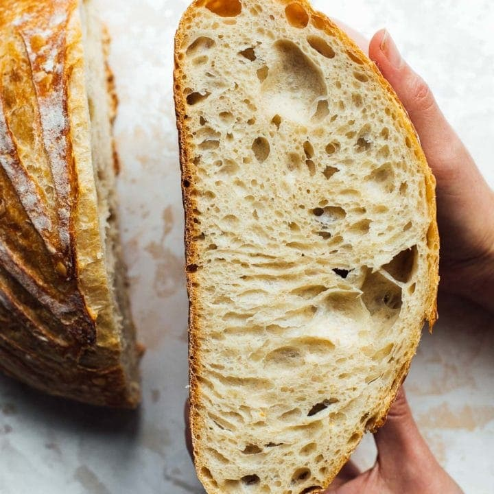 crumb shot of sourdough bread, holding in hands