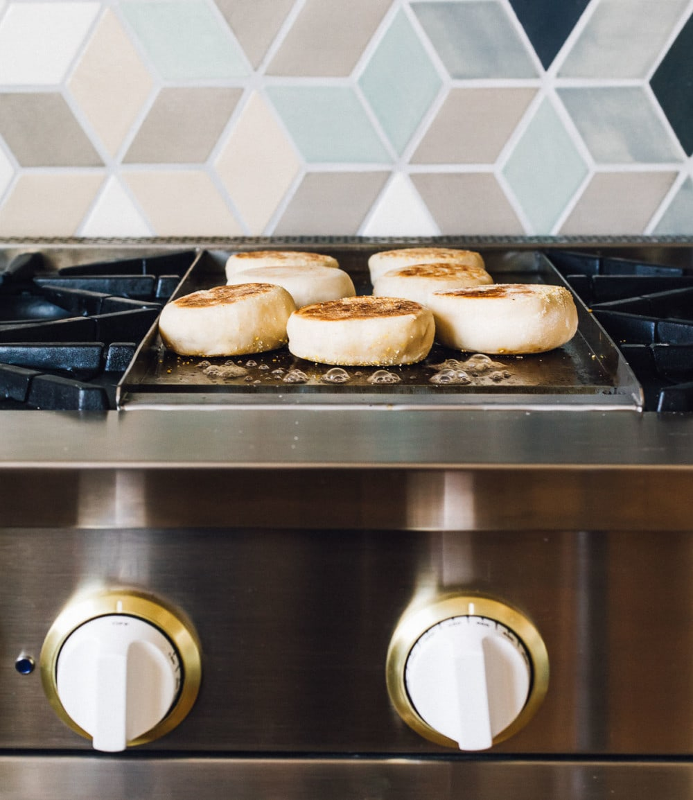 english muffins cooking on griddle