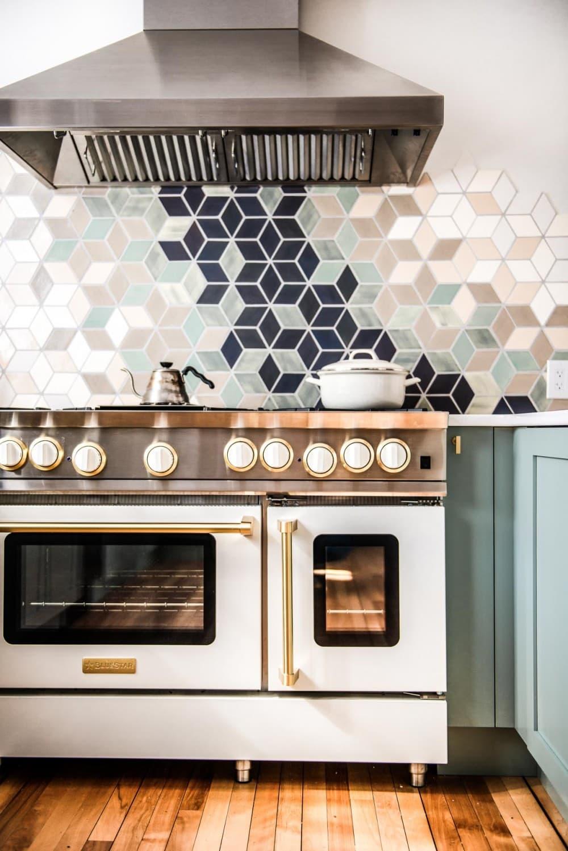white blue star range with gold trim in a white kitchen