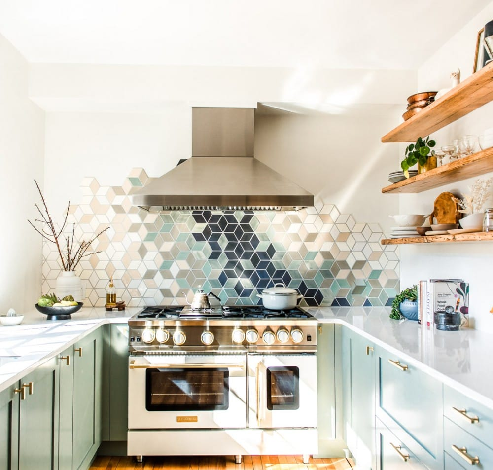 white kitchen with white blue star range and stainless steel hood