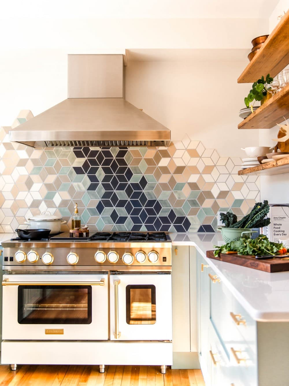 modern white kitchen with white range and stainless steel hood