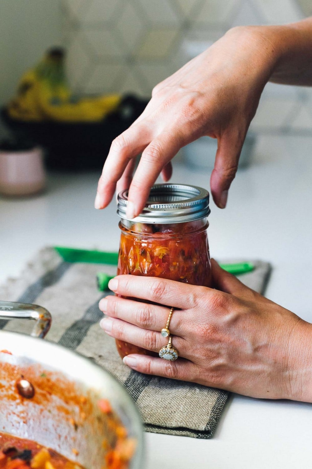 screwing the lid on a jar of salsa