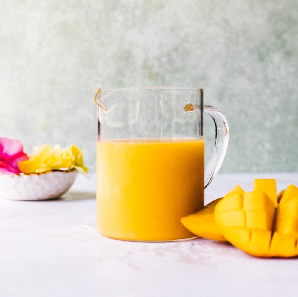 mango puree in a glass beaker