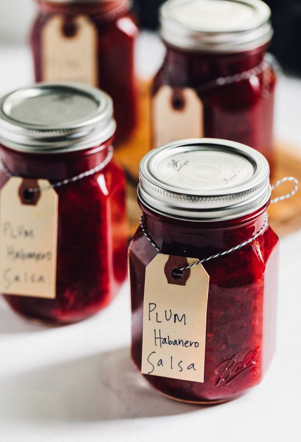 plum habanero salsa in glass ball jars, lined up