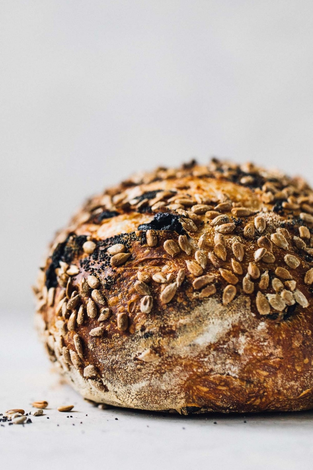 side view of a loaf of seeded sourdough bread