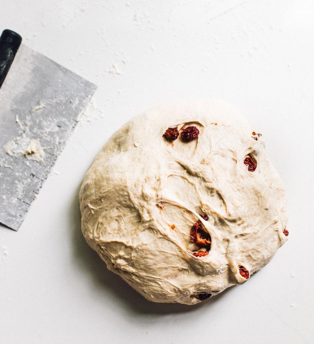 tart cherry sourdough in dough form, overhead photo