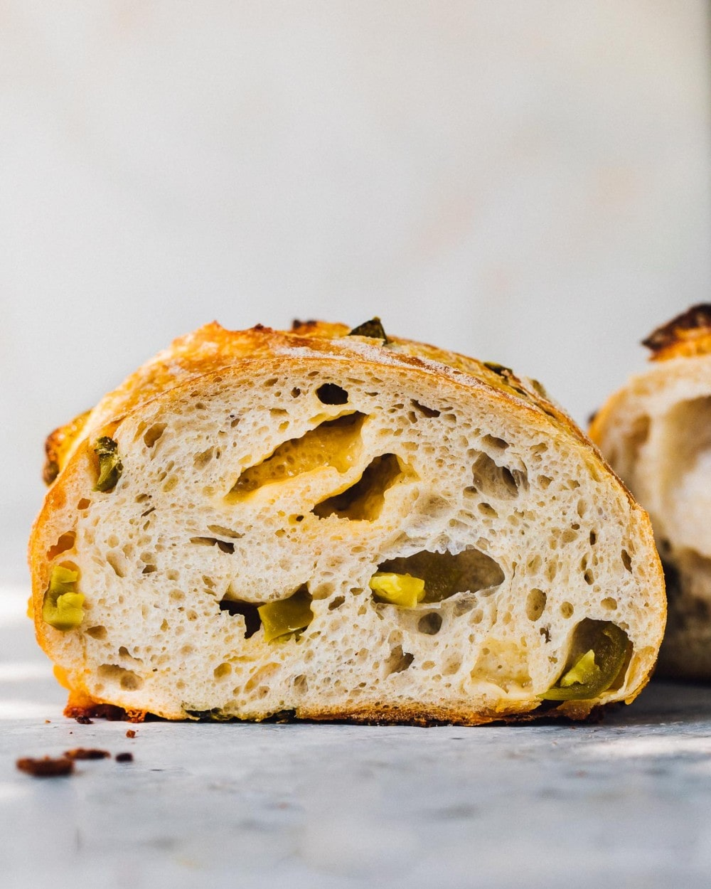 cross section of a loaf of cheese and jalapeno sourdough