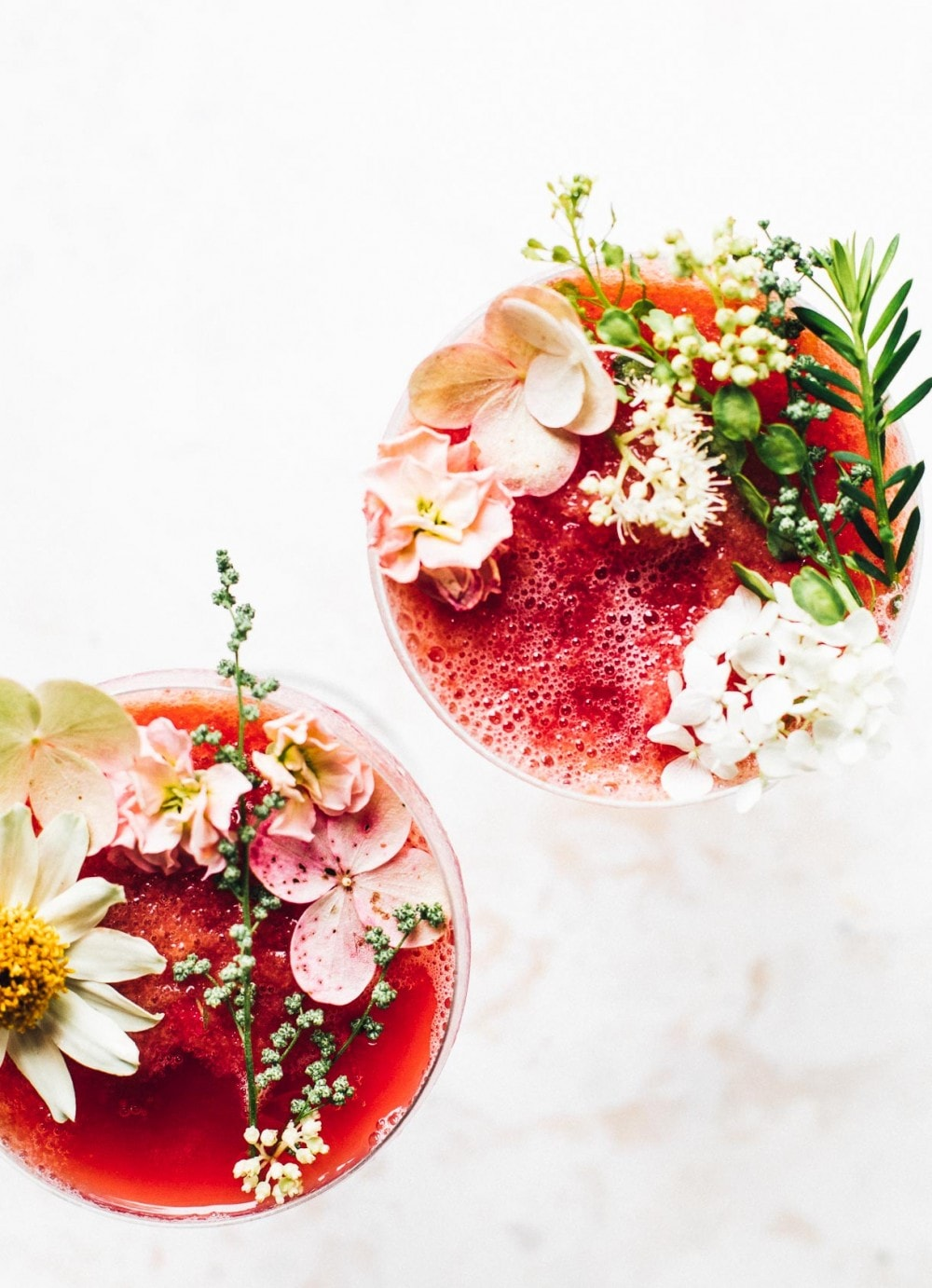 flower decorated frozen wine cocktails, two glasses next to each