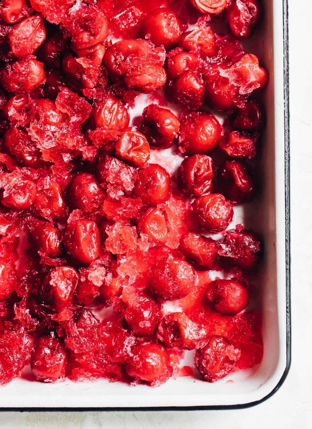 frozen tart cherries in a white enamel pan