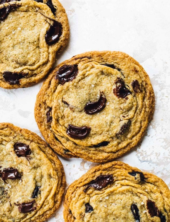 giant chocolate chip cookies on a board