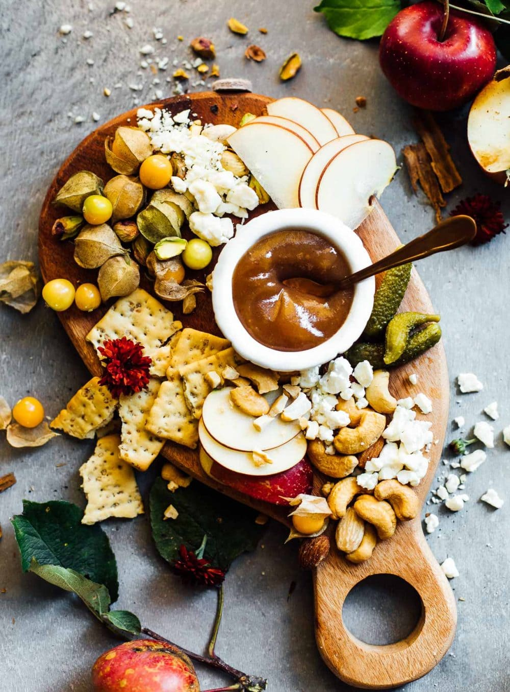 fall cheese board with apple butter, ground cherries, crackers, blue cheese, cashews