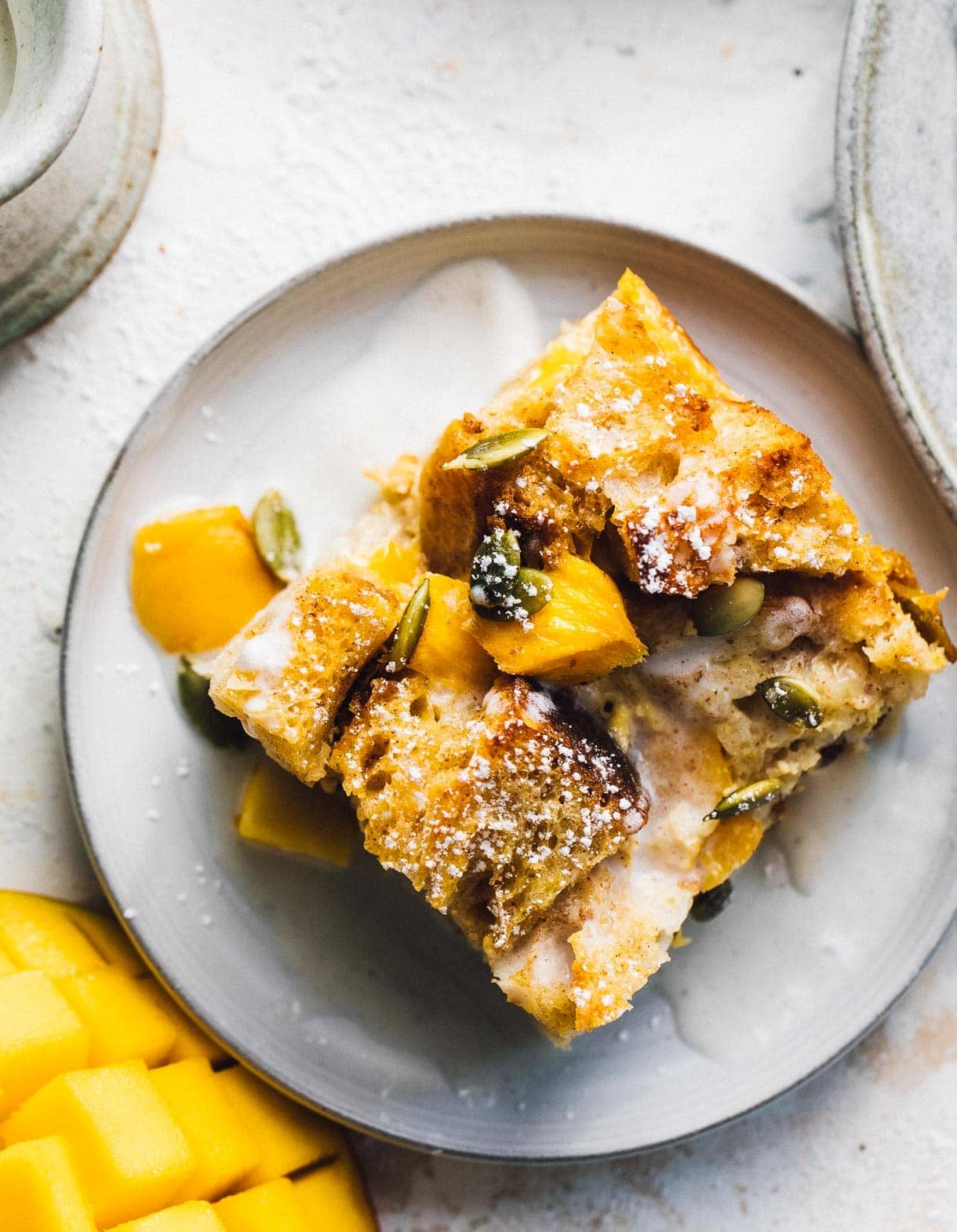 mango bread pudding on a plate