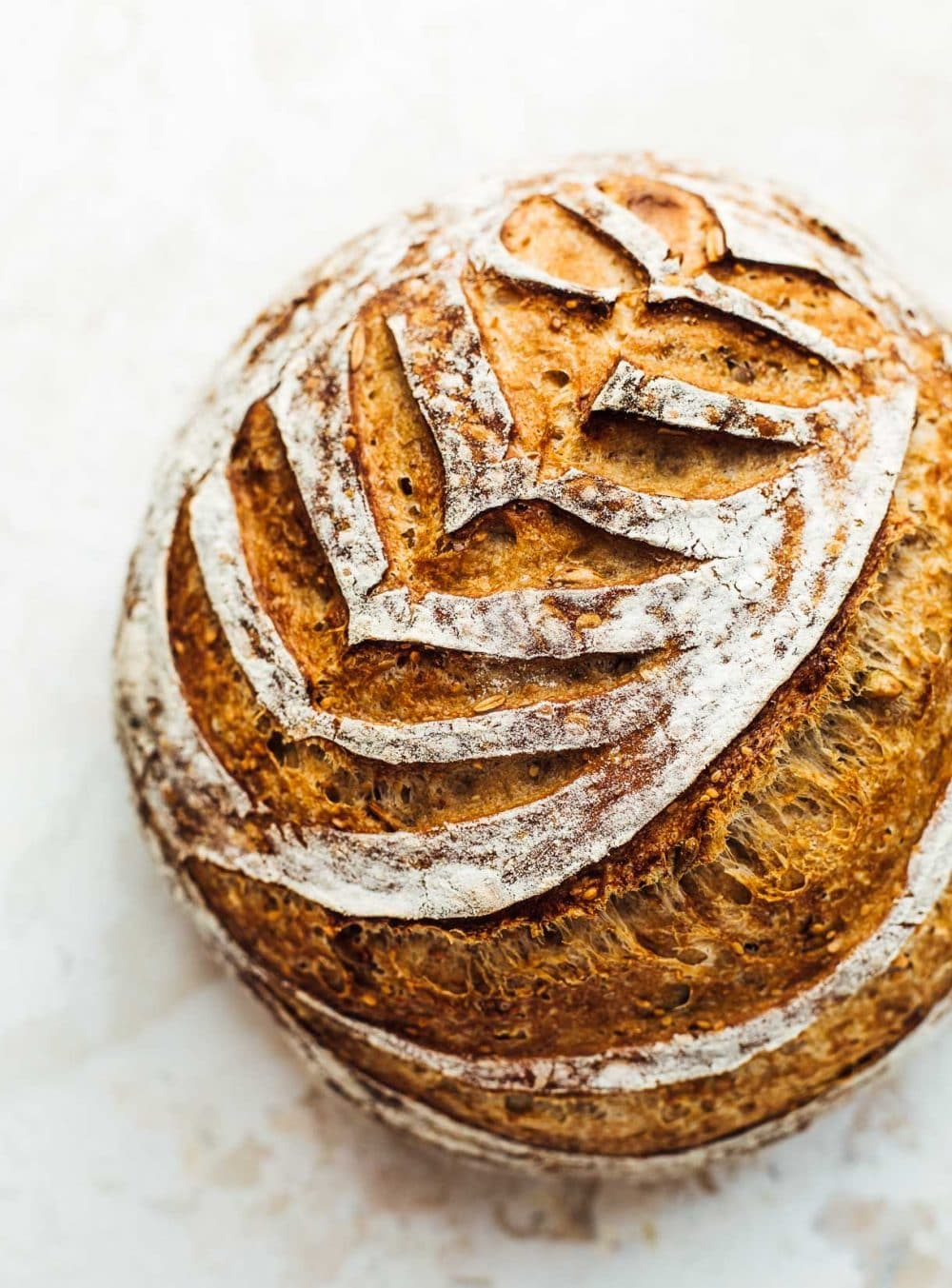 seeded sourdough bread with beautiful scoring