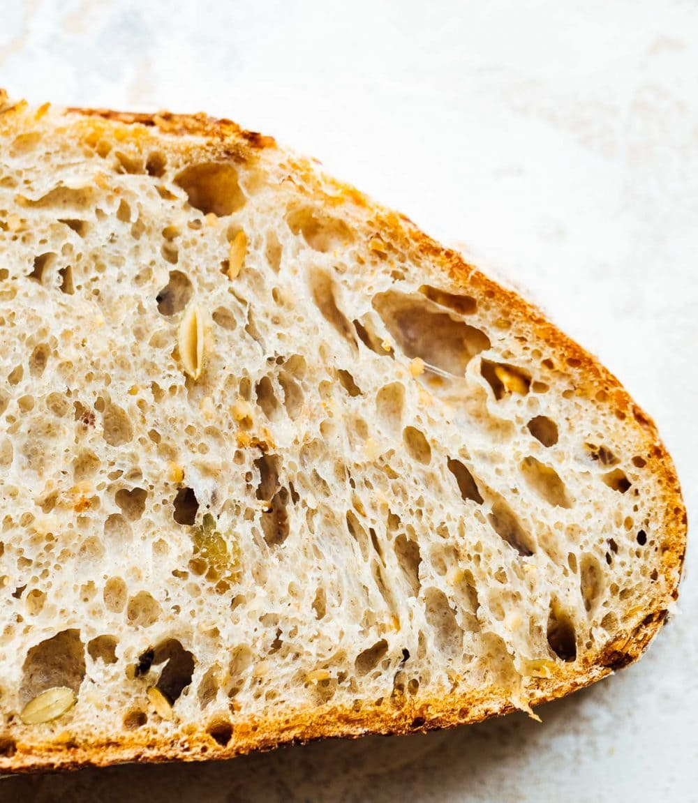 seeded sourdough bread, up close image