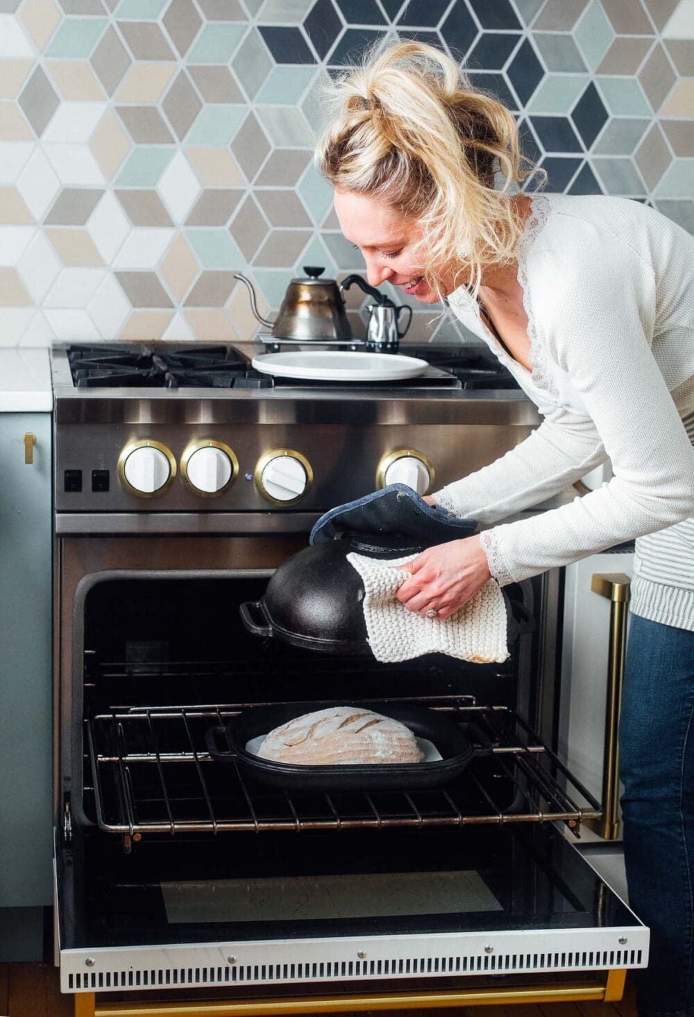 putting bread into a blue star oven