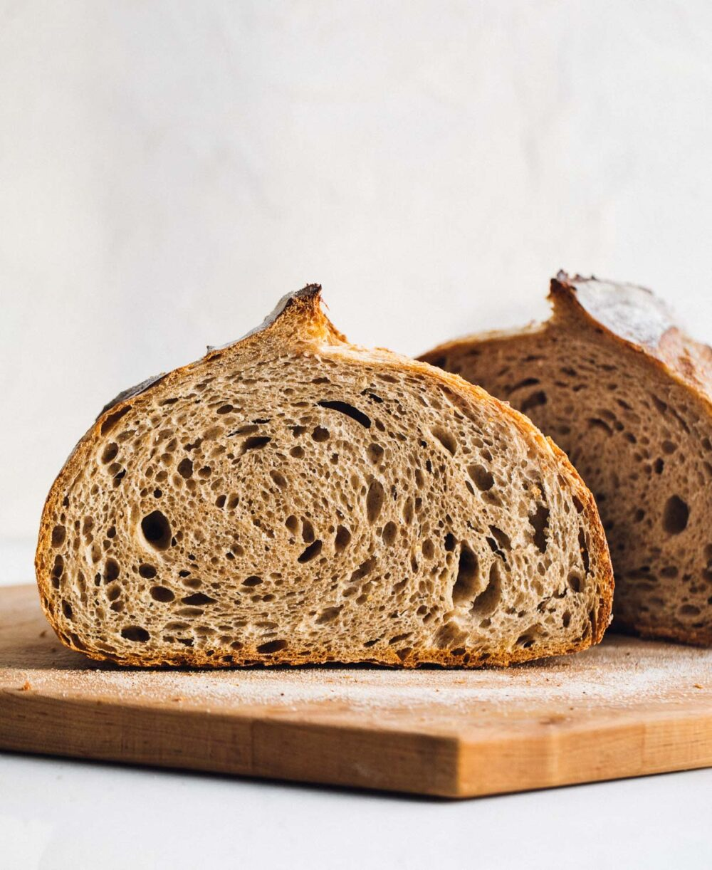 whole wheat sourdough bread, cut in half with crumb showing