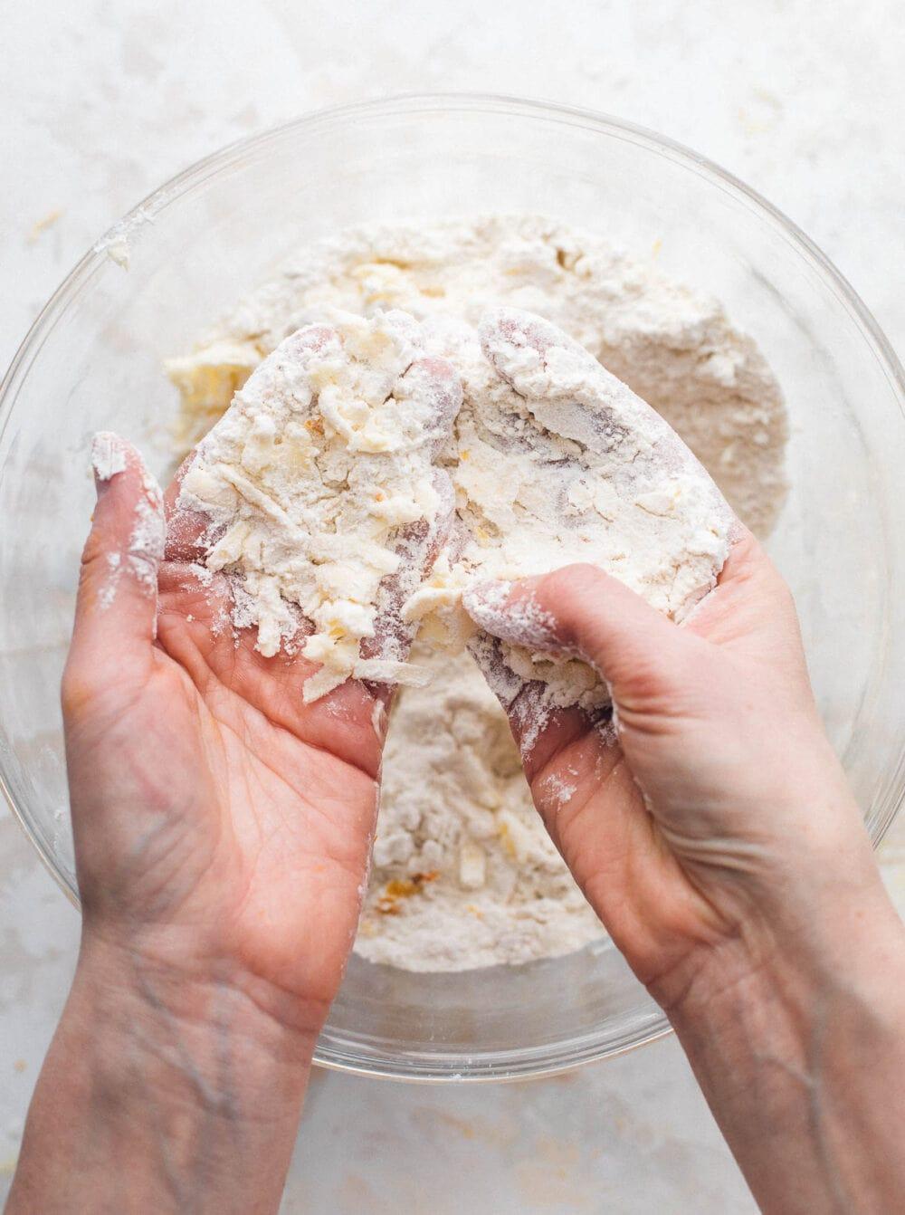 rubbing flour in between hands