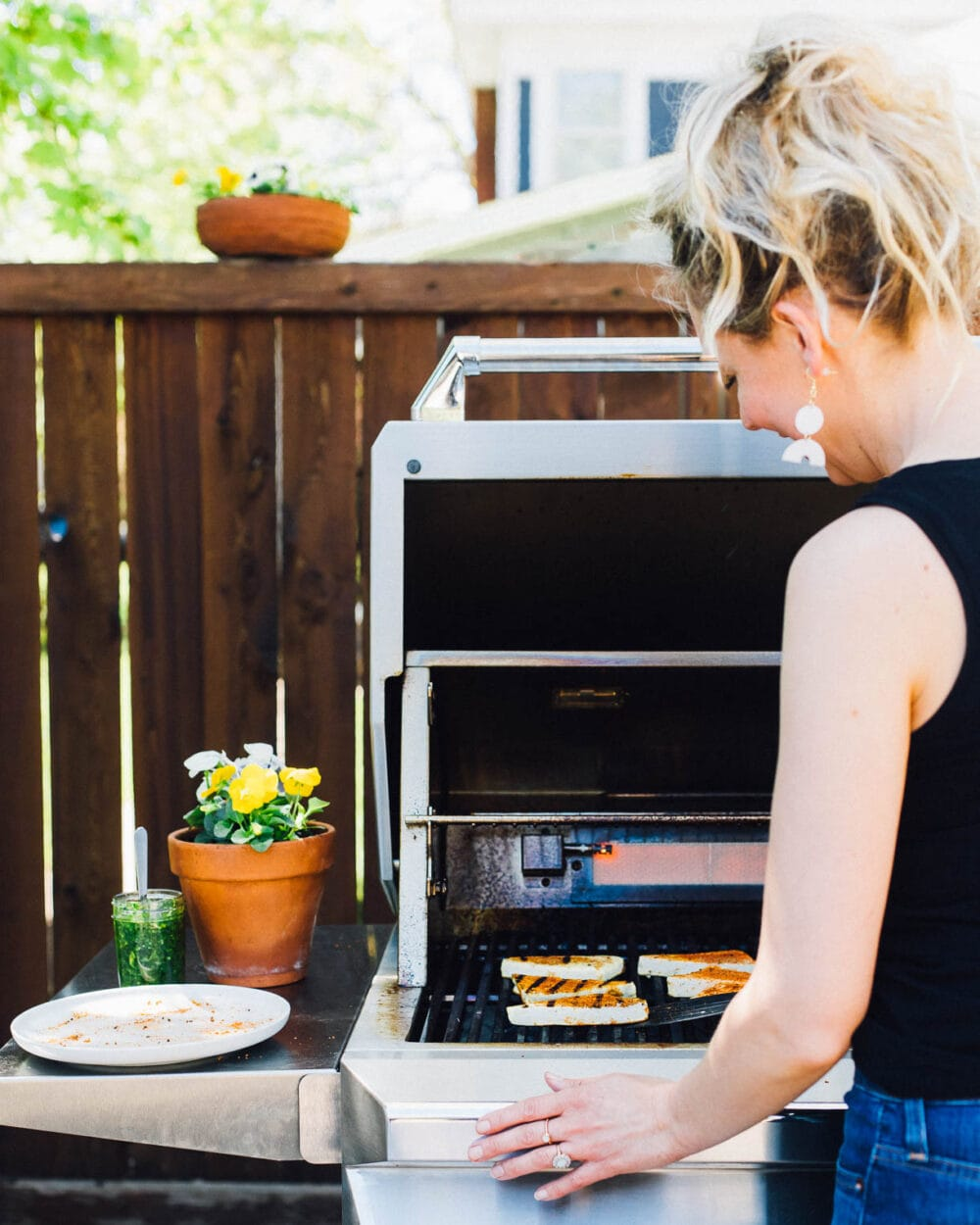 woman with blond hair grilling tofu