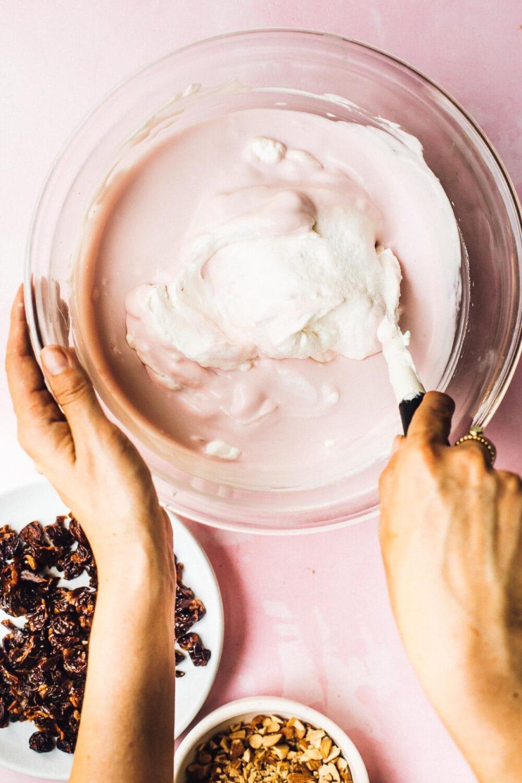 folding whipped cream into cherry ice cream base