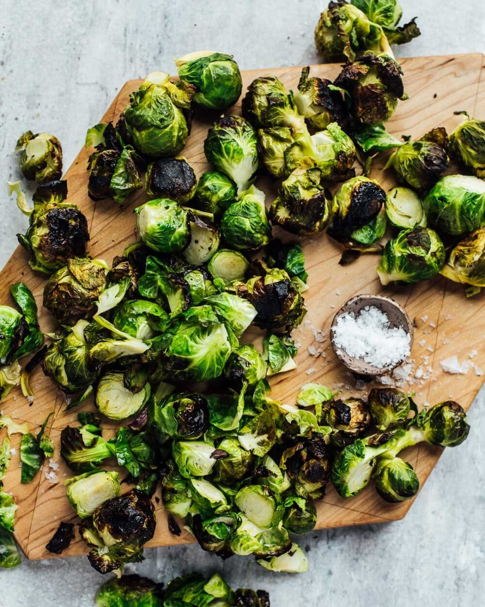 grilled brussels sprouts on a cutting board