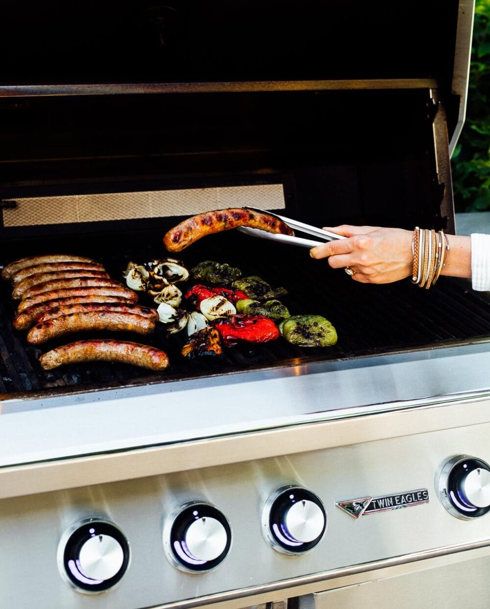 grilling brats with peppers and onions