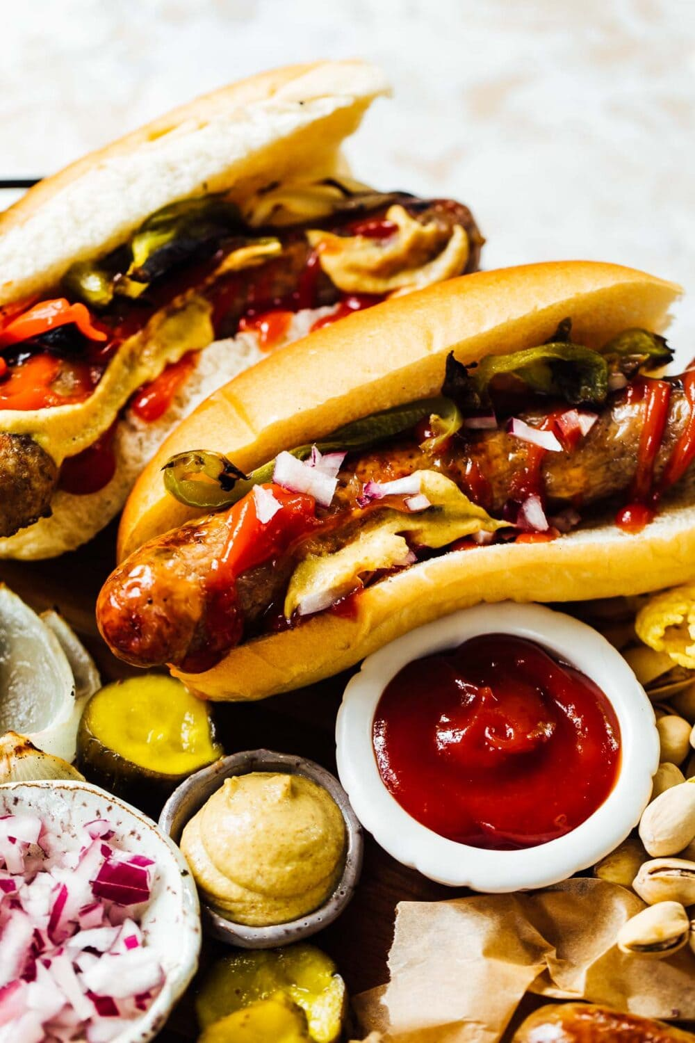 Grilled Brats in Buns with ketchup and mustard nearby
